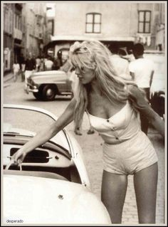 Brigitte Bardot. Surprised she didn't cause a traffic accident in this vintage 50s outfit.