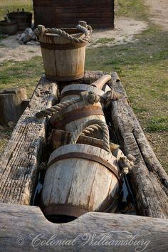 Wooden buckets in water trough