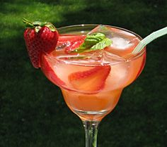 Strawberry Basil Margarita (2 1/4 cup Tequila  12 oz. can Frozen Limeade Concentrate 12 Strawberries 8 Basil Leaves  30 oz. Water)