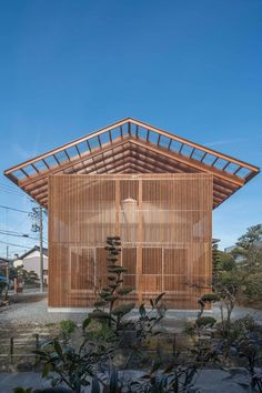 In Japan's Aichi Prefecture, Tokyo-based firm Mizuishi Architect Atelier has designed 'House in Otai' for a plot of land shared by two generations of the same family.