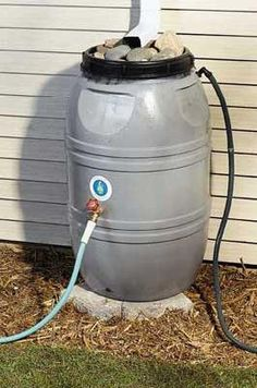 Mother Earth Magazine DIY Rain Barrel instructions for soft, warm free water perfect for plants, lawns, and many other outdoor applications.