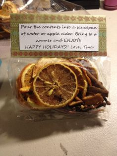 Homemade mulling spice - Dried lemon, orange and apple slices in the oven at 200 degrees for a few hours. Added cinnamon sticks, cloves and cinnamon and put it all in a ziplock bag for a few days. When I opened the bag it smelt great!! I put it in individual bags(I got at the dollar store!!) and cut out pieces of Christmas scrapbooking paper and folded it over and stapled it. Typed up the instructions on the computer and taped it to the paper. Easy homemade gift!!