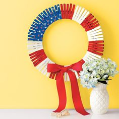 Turn heads with a decorative and festive clothespin wreath (it's perfect for the 4th of July, but can be easily updated for any and every holiday.)