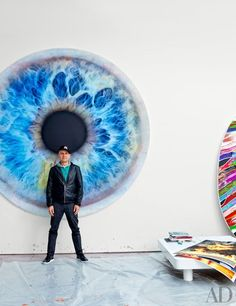 Marc Quinn in front of his 2011 painting 'We Share Our Chemistry with the Stars'