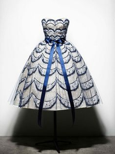 "Dior Haute Couture S/S 1956. ""Helvetie"". White organdy embroidered with crescent moons of blue lace and sequins."