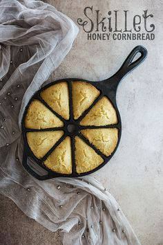 Buttery cornbread wedges infused with honey, baked in a cast iron wedge pan, and paired with honey butter.