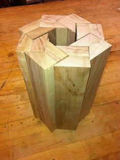 I don't know what this is supposed to be, but I saw it and wondered what one would end up with if they glued up a woodturning blank like this and left the top mostly untouched, so as to show off the sharp angles and lines, but turned the lower two-thirds to make a turned vessel.