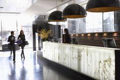 Hotel le Germain lobby (Calgary). Onyx. (visible light source). hotel le, boutique hotels, bathroom interior design, le germain, contemporary bathrooms, lobbi, bathroom lighting, lighting fixtures, desk