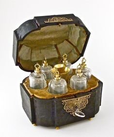 """c1775 French Toiletry Box or """"necessaire"""", containing 6 cut glass bottles, gilt silver mounts and stoppers, gilt beaker and funnel. Silver marks on each. Shagreen (shark skin) covered box, silk and velvet interior, elaborate hardware and key."""