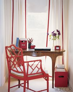 red chair wooden desk white with red accent drape.