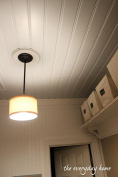 A Southern Home Tour at The Everyday Home: Adding pale-blue painted beadboard to the Laundry Room Ceiling.
