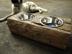 Wood Dog Dish Holder reclaimed oak barn beam. Why didn't I think of this. Those same dog dishes are being pushed around the house now..