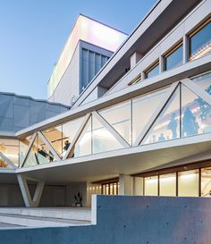 Crinkled fibre-cement panels clad the facade of this theatre extension.