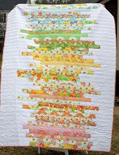 What a beautiful summer or spring quilt! The strips are so flowery and pretty, perfect for scraps.