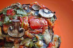 Receta vegetariana de berenjenas rellenas de nueces y setas.