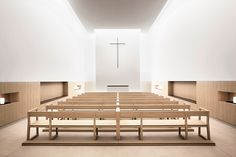 Padre Rubbings Church-Elsa Urquijo Architects | intimate rows of seating are positioned in front of a simple altar devoid of decoration