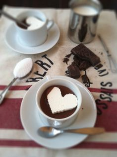 Whipped Cream Hearts!  1) spread whipped cream on a cookie sheet 2) put in freezer 3) cut out hearts with cookie cutter 4) place in hot chocolate