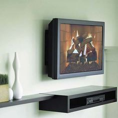 This is a wall-mounted TV with a floating shelf to hold the DVD player. It's simple, but still hides cords and looks great on the wall! living rooms, floating shelves, room redo, float shelf, decorating ideas, old houses, natural wood, display shelves, dvd player
