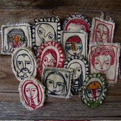 Little embroidered heads