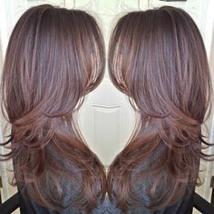 Classy long layered hairstyle cascading along the shoulders can be one of the best loose hairstyles for thin hair, deep chocolate color perfectly completes the look
