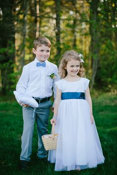 ring bearer and flower girl, photo by Emily Delamater http://ruffledblog.com/flanagan-farm-wedding #weddings #flowergirls
