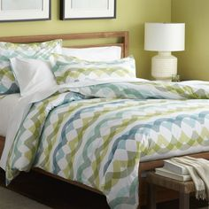Italian-made linens overlap translucent waves of teal, citron and green creating a sea of soothing color in a vibrant pattern that signals casual and contemporary.  Duvet has a hidden-button closure and interior fabric ties to stabilize duvet insert.  Shams have overlapping flap closures.  Duvet inserts and bed pillows also available.