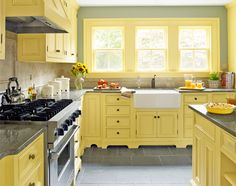 Furniture-inspired cabinets painted a custom yellow and a farmhouse sink evoke the past of the home of our 2014 Reader Remodel Contest winners. Sink: Shaws. Faucet: Moen. Range: Viking