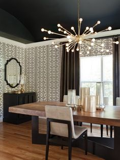 Here's a room where the designer wasn't afraid to set a statement chandelier against the dark color of ceiling. Absolutely stunning!