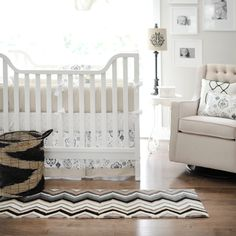 A #white #crib looks super modern with a #black #chevron #rug in the #nursery.