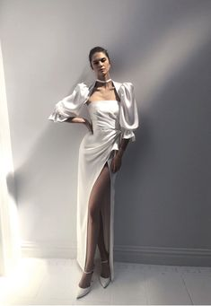 Sleek wedding dress with sleeves and split | Pin discovered by Kelly's Closet bridal boutique in Atlanta, Georgia