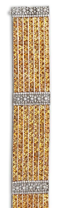 A diamond and yellow sapphire bracelet  the wide bracelet designed as three panels of yellow sapphires, each connected with round brilliant-cut diamond links of floral design; estimated total sapphire weight: 80.00 carats; estimated total diamond weight: 2.00 carats; mounted in eighteen karat white gold; length: 7 1/4in.
