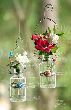 <p>Hanging Beaded Glass Flower Vases</p>