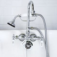 Charming #Fixtures: An #Edwardian-style tub filler completes the #clawfoot #tub. Tub #faucet and #handshower: Van Dyke's Restorers - www.vandykes.com