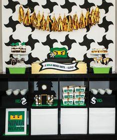 Lego Ninja Warrior Ninjago Inspired Birthday Party:– Ninjago shuriken throwing star patterned dessert table backdrop & gold tassel garland