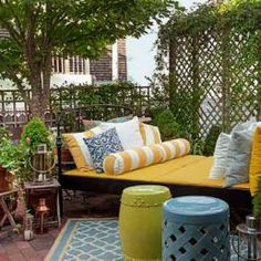 You dont need a big garden to make an engaging and entertaining space. This small outdoor living space draws from inside interior principles (such as multiple seating options, coffee tables, zoning and lighting).