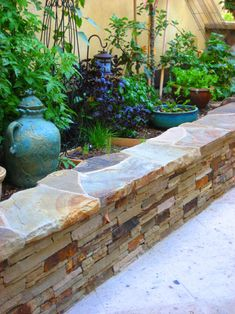 stacked stone as seat wall planter