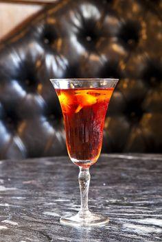 Gotham by Julie Reiner:  1 ½ oz Hangar 1 Straight Vodka 1 ½ oz Cocchi Americano Rosa ¼ oz Ramazzotti Amaro 2 dashes orange bitters  - Stir over ice and strain into coupe glass.