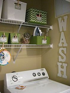 Small laundry room organization- love splashes of color and baskets for organizing
