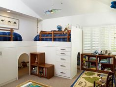 Erica Islas created a play cave with lofted contemporary white lacquer beds.