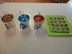 Minecraft snacks. Lava, water, sticks and Creeper heads. (M's, pretzels, and rice crispy treats.)