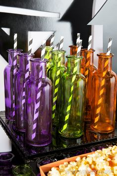 Throwing a Halloween bash? Brightly colored bottles will help decorate your table and they can double as party favors!
