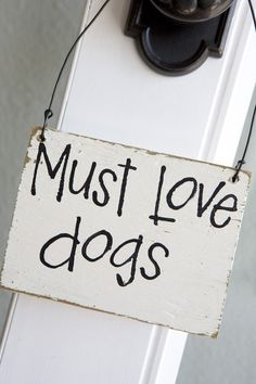 http://www.etsy.com/listing/55702888/must-love-dogs-reused-barn-wood-floor