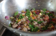A quick stir fry with pork, sweet corn, onions and tomatoes
