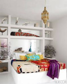 Ikat Pillows + Vintage Fabric. A Sunny Home On The Adriatic Coast - Southern Italy Home - ELLE DECOR