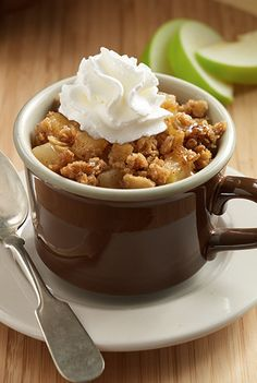A simple yet delicious easy apple crisp recipe made in microwaveable mugs with tart apples, sweet granola, brown sugar and cinnamon. A warm and quick comforting fall dessert.