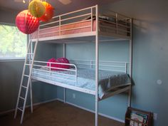 If you start the first bunk on the floor you can comfortably fit three children in one bedroom. Another type of bunk  bed would help with storage at the ends.