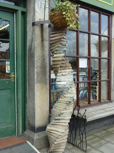 Twisting pillar of wax covered books