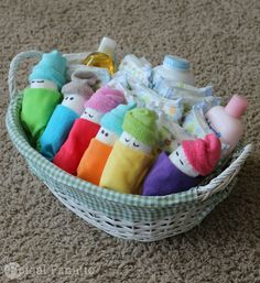 Making diaper babies for a baby shower are a cute and inexpensive gift idea!