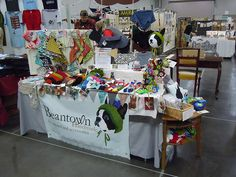 A nice set up at a craft show! Great table runner.