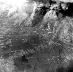 Smoke billows after an Allied bombing mission at Caens, France, in 1944 . (Photography by RCAF 414 Photo Squadron, courtesy Jack Ford)